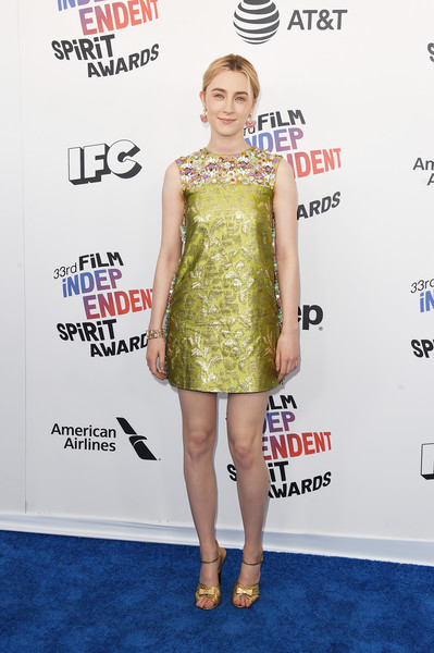 Saoirse Ronan went for retro cuteness in a chartreuse Prada shift dress with an ornately embellished yoke at the 2018 Film Independent Spirit Awards.