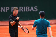 Jamie Murray of Great Britain and partner Bruno Soares of Brazil speak during their mens doubles match against Maximo Gonzalez of Argentina and Nicolas Jarry of Chile during day seven of the 2018 French Open at Roland Garros on June 2, 2018 in Paris, France.