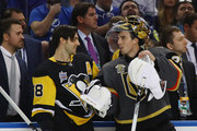 Kris Letang #58 of the Pittsburgh Penguins chats with Marc-Andre Fleury #29 of the Vegas Golden Knights during the 2018 GEICO NHL All-Star Skills Competition at Amalie Arena on January 27, 2018 in Tampa, Florida.