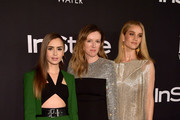 (L-R) Lily Collins, Clare Waight Keller, and Rosie Huntington-Whiteley attend the 2018 InStyle Awards at The Getty Center on October 22, 2018 in Los Angeles, California.