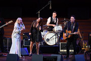 "Michelle Phillips, Jade Castrinos, and Jakob Dylan perform during the 2018 LA Film Festival opening night premiere of ""Echo In The Canyon"" at John Anson Ford Amphitheatre on September 20, 2018 in Hollywood, California."