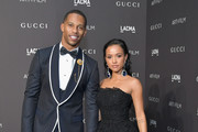 Former NFL player Victor Cruz (L) and actor-model Karrueche Tran attend 2018 LACMA Art + Film Gala honoring Catherine Opie and Guillermo del Toro presented by Gucci at LACMA on November 3, 2018 in Los Angeles, California.