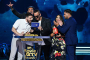 (L-R) TV personalities Vinny Guadagnino, Paul DelVecchio aka DJ Pauly D, Mike Sorrentino aka The Situation, Deena Nicole Cortese, and Ronnie Ortiz-Magro speak onstage during the 2018 MTV Movie And TV Awards at Barker Hangar on June 16, 2018 in Santa Monica, California.