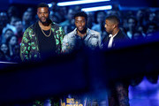(L-R) Actors Winston Duke, Chadwick Boseman and Michael B. Jordan accept the Best Movie award for 'Black Panther' onstage during the 2018 MTV Movie And TV Awards at Barker Hangar on June 16, 2018 in Santa Monica, California.