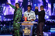 (L-R) Actors Winston Duke, Chadwick Boseman, and Michael B. Jordan accept the Best Movie (Presented by Toyota) award for 'Black Panther' onstage during the 2018 MTV Movie And TV Awards at Barker Hangar on June 16, 2018 in Santa Monica, California.