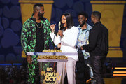 (L-R) Actor Winston Duke, host Tiffany Haddish, actor Michael B. Jordan, and actor Chadwick Boseman speak after 'Black Panther' won the Best Movie award (Presented by Toyota) onstage during the 2018 MTV Movie And TV Awards at Barker Hangar on June 16, 2018 in Santa Monica, California.
