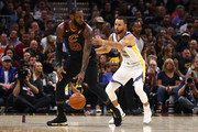 LeBron James #23 of the Cleveland Cavaliers dribbles with the ball defended by Stephen Curry #30 of the Golden State Warriors during Game Four of the 2018 NBA Finals at Quicken Loans Arena on June 8, 2018 in Cleveland, Ohio. NOTE TO USER: User expressly acknowledges and agrees that, by downloading and or using this photograph, User is consenting to the terms and conditions of the Getty Images License Agreement.