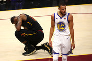 LeBron James #23 of the Cleveland Cavaliers reacts as Stephen Curry #30 of the Golden State Warriors looks on in the first half during Game Four of the 2018 NBA Finals at Quicken Loans Arena on June 8, 2018 in Cleveland, Ohio. NOTE TO USER: User expressly acknowledges and agrees that, by downloading and or using this photograph, User is consenting to the terms and conditions of the Getty Images License Agreement.