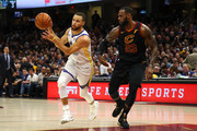 Stephen Curry #30 of the Golden State Warriors drives to the basket defended by LeBron James #23 of the Cleveland Cavaliers in the first half during Game Four of the 2018 NBA Finals at Quicken Loans Arena on June 8, 2018 in Cleveland, Ohio. NOTE TO USER: User expressly acknowledges and agrees that, by downloading and or using this photograph, User is consenting to the terms and conditions of the Getty Images License Agreement.