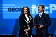 Actress Lynda Carter and Nicklas Backstrom of the Washington Capitals present the NHL General Manager of the Year Award onstage at the 2018 NHL Awards presented by Hulu at The Joint inside the Hard Rock Hotel & Casino on June 20, 2018 in Las Vegas, Nevada.