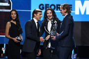 Actress Lynda Carter and Nicklas Backstrom of the Washington Capitals present the NHL General Manager of the Year Award to George McPhee of the Vegas Golden Knights onstage at the 2018 NHL Awards presented by Hulu at The Joint inside the Hard Rock Hotel & Casino on June 20, 2018 in Las Vegas, Nevada.