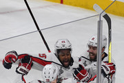 Devante Smith-Pelly #25 of the Washington Capitals celebrates with Christian Djoos #29 and Chandler Stephenson #18 after scoring a third-period goal against the Vegas Golden Knights in Game Five of the 2018 NHL Stanley Cup Final at T-Mobile Arena on June 7, 2018 in Las Vegas, Nevada. The Capitals defeated the Golden Knights 4-3.