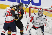 (L-R) Nicklas Backstrom #19 of the Washington Capitals and David Perron #57 of the Vegas Golden Knights battle for position in the crease next to Braden Holtby #70 of the Capitals in the second period of Game Five of the 2018 NHL Stanley Cup Final at T-Mobile Arena on June 7, 2018 in Las Vegas, Nevada. The Capitals defeated the Golden Knights 4-3.