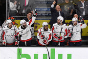 (L-R) Lars Eller #20, Brett Connolly #10, Devante Smith-Pelly #25, head coach Barry Trotz, Tom Wilson #43 and Evgeny Kuznetsov #92 of the Washington Capitals begin to celebrate on the bench late in the third period of Game Five of the 2018 NHL Stanley Cup Final against the Vegas Golden Knights at T-Mobile Arena on June 7, 2018 in Las Vegas, Nevada. The Capitals defeated the Golden Knights 4-3.