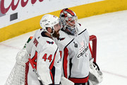 Brooks Orpik and Braden Holtby Photos Photo
