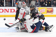 Pierre-Edouard Bellemare #41 of the Vegas Golden Knights takes a shot on Braden Holtby #70 as Dmitry Orlov #9 of the Washington Capitals defends during the first period in Game Five of the 2018 NHL Stanley Cup Final at T-Mobile Arena on June 7, 2018 in Las Vegas, Nevada.