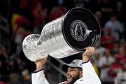 Devante Smith-Pelly #25 of the Washington Capitals hoists the Stanley Cup after his team defeated the Vegas Golden Knights 4-3 in Game Five of the 2018 NHL Stanley Cup Final at T-Mobile Arena on June 7, 2018 in Las Vegas, Nevada.