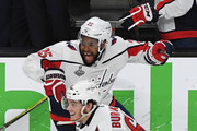 Andre Burakovsky #65 and Devante Smith-Pelly #25 of the Washington Capitals celebrate the team's 4-3 win over the Vegas Golden Knights in Game Five of the 2018 NHL Stanley Cup Final at T-Mobile Arena on June 7, 2018 in Las Vegas, Nevada.