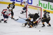 Marc-Andre Fleury #29 of the Vegas Golden Knights makes a diving save on a shot by Jakub Vrana #13 of the Washington Capitals as Nate Schmidt #88 and Shea Theodore #27 of the Golden Knights defend in the third period of Game Five of the 2018 NHL Stanley Cup Final at T-Mobile Arena on June 7, 2018 in Las Vegas, Nevada. The Capitals defeated the Golden Knights 4-3.