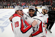 Nicklas Backstrom #19 and Devante Smith-Pelly #25 of the Washington Capitals celebrate their teams 4-3 win over the Vegas Golden Knights in Game Five of the 2018 NHL Stanley Cup Final at T-Mobile Arena on June 7, 2018 in Las Vegas, Nevada.