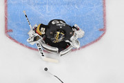 Marc-Andre Fleury #29 of the Vegas Golden Knights blocks a shot by Jakub Vrana #13 of the Washington Capitals as Shea Theodore #27 of the Golden Knights defends in the second period of Game One of the 2018 NHL Stanley Cup Final at T-Mobile Arena on May 28, 2018 in Las Vegas, Nevada. The Golden Knights defeated the Capitals 6-4.