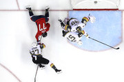 T.J. Oshie #77 of the Washington Capitals and Shea Theodore #27 of the Vegas Golden Knights get tangled up as David Perron #57 and Marc-Andre Fleury #29 of the Vegas Golden Knights defend in Game Three of the 2018 NHL Stanley Cup Final at Capital One Arena on June 2, 2018 in Washington, DC. The Capitals defeated the Golden Knights 3-1.