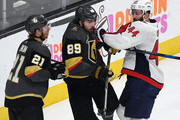 Brooks Orpik #44 of the Washington Capitals shoves Alex Tuch #89 of the Vegas Golden Knights in front of Cody Eakin #21 of the Golden Knights after Tuch's shot was blocked by Braden Holtby (not pictured) #70 of the Capitals late in the third period of Game Two of the 2018 NHL Stanley Cup Final at T-Mobile Arena on May 30, 2018 in Las Vegas, Nevada. The Capitals defeated the Golden Knights 3-2.