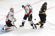 Ryan Reaves #75 of the Vegas Golden Knights and Christian Djoos #29 of the Washington Capitals go for the puck as Braden Holtby #70 defends the goal in Game Two of the 2018 NHL Stanley Cup Final at T-Mobile Arena on May 30, 2018 in Las Vegas, Nevada.