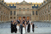 The players of Team USA pose with their wives and partners on the steps of the Palace of Versailles prior to the Ryder Cup Gala ahead of the 2018 Ryder Cup on September 26, 2018 in Versailles, France.