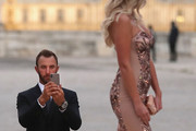 Dustin Johnson of the United States takes a picture of partner Paulina Gretzky before the Ryder Cup Gala dinner at the Palace of Versailles ahead of the 2018 Ryder Cup on September 26, 2018 in Versailles, France.