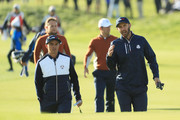 Dustin Johnson of the United States and Rickie Fowler of the United States in conversation during the morning fourball matches of the 2018 Ryder Cup at Le Golf National on September 29, 2018 in Paris, France.