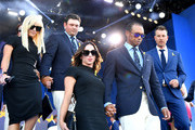Tiger Woods of the United States, girlfriend Erica Herman, Patrick Reed of the United States and wife Justine Reed depart the opening ceremony for the 2018 Ryder Cup at Le Golf National on September 27, 2018 in Paris, France.
