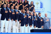 Members of the united states team (Back L-R) Patrick Reed, Phil Mickelson, Brooks Koepka, Dustin Johnson, Rickie Fowler, Tony Finau, Bryson DeChambeau, (Front L-R) Tiger Woods, Bubba Watson, Justin Thomas, Jordan Spieth, Webb Simpson and Captain Jim Furyk attend the opening ceremony for the 2018 Ryder Cup at Le Golf National on September 27, 2018 in Paris, France.