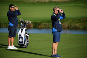 Caddie Mark Fulcher and caddie Gareth Lord use range finders during practice ahead of the 2018 Ryder Cup at Le Golf National on September 25, 2018 in Paris, France.