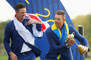 Henrik Stenson of Europe stands with Justin Rose of Europe as he lifts The Ryder Cup during singles matches of the 2018 Ryder Cup at Le Golf National on September 30, 2018 in Paris, France.