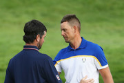 Henrik Stenson of Europe is congratulated by Bubba Watson of the United States during singles matches of the 2018 Ryder Cup at Le Golf National on September 30, 2018 in Paris, France.
