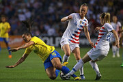 Becky Sauerbrunn #4 and Emily Sonnett #22 of the United States take down Beatriz #16 of Brazil during the 2018 Tournament Of Nations at Toyota Park on August 2, 2018 in Bridgeview, Illinois.