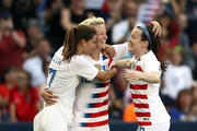 Megan Rapinoe #15 of the United States is celebrates with Tobin Heath #17 and Rose Lavelle #16 after scoring during their Tournament Of Nations match against Japan at Children's Mercy Park on July 26, 2018 in Kansas City, Kansas.