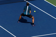 Jamie Murray of Great Britain and partner Bruno Soares of Brazil serve during their men's doubles quarter-final match against Malek Jaziri of Tunisia and Radu Albot of Moldova on Day Ten of the 2018 US Open at the USTA Billie Jean King National Tennis Center on September 5, 2018 in the Flushing neighborhood of the Queens borough of New York City.
