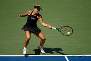 Andrea Petkovic of Germany returns the ball during her women's singles first round match against Jelena Ostapenko of Latvia on Day Two of the 2018 US Open at the USTA Billie Jean King National Tennis Center on August 28, 2018 in the Flushing neighborhood of the Queens borough of New York City.