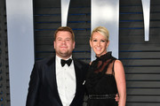 James Corden (L) and Julia Carey attend the 2018 Vanity Fair Oscar Party hosted by Radhika Jones at Wallis Annenberg Center for the Performing Arts on March 4, 2018 in Beverly Hills, California.