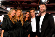 (L-R) Martha Hunt, Romee Strijd, Taylor Hill, Andrew Taggart, and  Alex Pall pose backstage during the 2018 Victoria's Secret Fashion Show at Pier 94 on November 8, 2018 in New York City.
