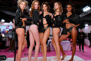 (L-R) Maggie Laine, Alexina Graham, Myrthe Bolt, Barbara Palvin, and Leomie Anderson prepare backstage during 2018 Victoria's Secret Fashion Show in New York at Pier 94 on November 8, 2018 in New York City.