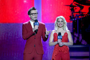 (EDITORIAL USE ONLY. NO COMMERCIAL USE) Hosts Bobby Bones (L) and Candace Cameron Bure speak onstage during the 2018 iHeartCountry Festival By AT&T at The Frank Erwin Center on May 5, 2018 in Austin, Texas.