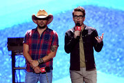 Jason Aldean (L) and Bobby Bones speak onstage during the 2018 iHeartRadio Music Festival at T-Mobile Arena on September 21, 2018 in Las Vegas, Nevada.