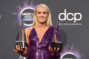 Carrie Underwood, winner of the Favorite Album - Country award for 'Cry Pretty' and Favorite Female Artist - Country award, poses in the press room during the 2019 American Music Awards at Microsoft Theater on November 24, 2019 in Los Angeles, California.