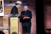 (L-R) John C. Reilly and John Prine onstage during the 2019 Americana Honors & Awards at Ryman Auditorium on September 11, 2019 in Nashville, Tennessee.