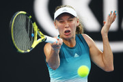 Caroline Wozniacki of Denmark plays a forehand in her first round match against Alison Van Uytvanck of Belgium during day one of the 2019 Australian Open at Melbourne Park on January 14, 2019 in Melbourne, Australia.