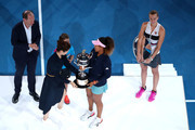 Naomi Osaka of Japan is presented with the Daphne Akhurst Memorial Cup from Li Na following victory in her Women's Singles Final match against Petra Kvitova of the Czech Republic during day 13 of the 2019 Australian Open at Melbourne Park on January 26, 2019 in Melbourne, Australia.