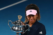 Naomi Osaka of Japan poses with the Daphne Akhurst Memorial Cup during day 13 of the 2019 Australian Open at Melbourne Park on January 26, 2019 in Melbourne, Australia.